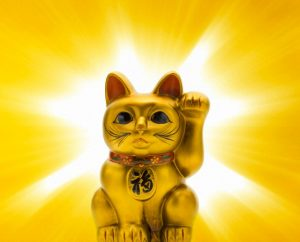 Japanese porcelain lucky cat (Maneki Neko) --- Image by © amanaimages/Corbis
